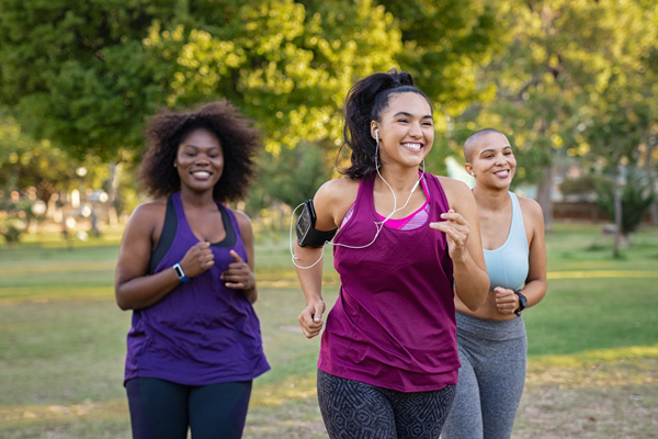 Group of three women jogging in a park