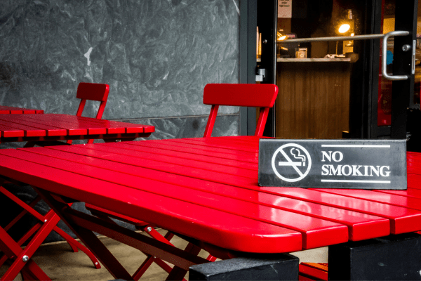 no smoking sign on red table