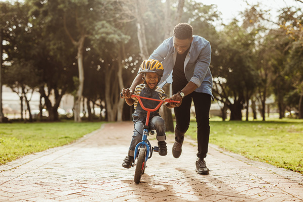 Man teaching his son how to ride a bike