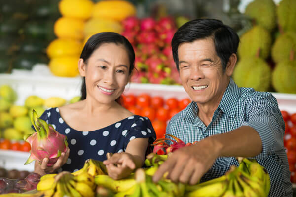 Couple buying fruits