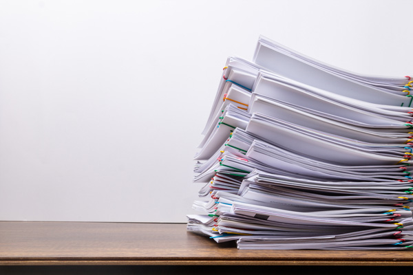 Stacks of paper on desk